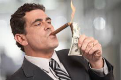 Man lighting a cigar with a dollar bill