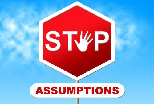 A stop sign warning against making assumptions